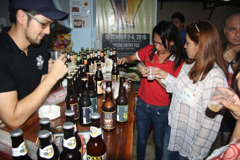 Erika Gines from Sunstar Pampanga samples some Crazy Carabao craft beer