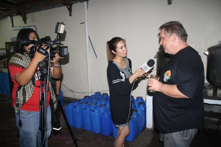 Mike explaining the ins and out of craft brewing to ABS-CBN Pampanga