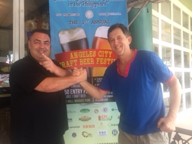 Mike Wöhlert of Meister Solar and Ted Lerner of TLC Promotions seal the deal that will see Meister Solar be a major sponsor of the AC Craft Beer Festival